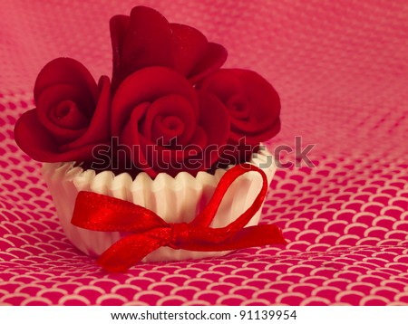 cupcake with red roses decor - stock photo