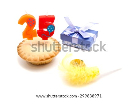 cupcake with twenty five years birthday candle, whistle and gift on white background - stock photo