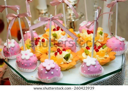 Cupcakes and fruit tartlets - stock photo