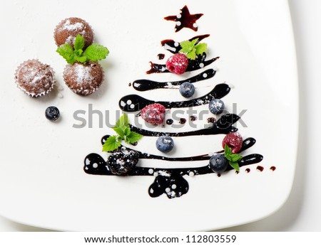 Cupcakes  and sweet  christmas tree with berries and mint - stock photo