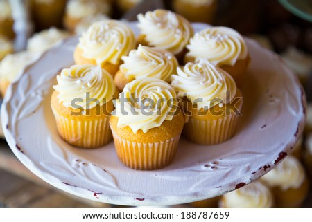 Cupcakes at a wedding reception looking great. - stock photo