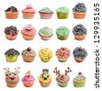 Cupcakes collection against white background in front of white background - stock photo