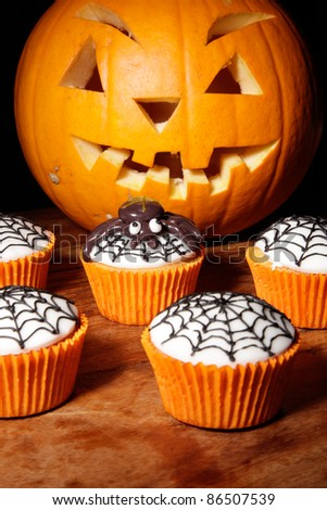 cupcakes decorated for halloween celebration. - stock photo