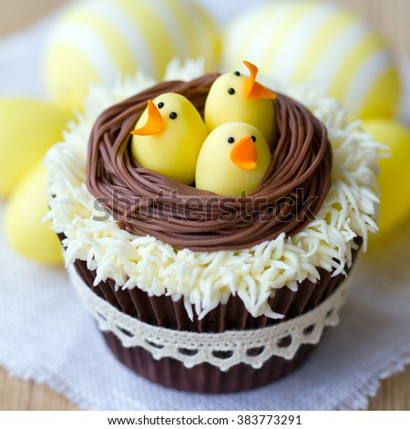 Cupcakes decorated with fondant Easter chicks - stock photo