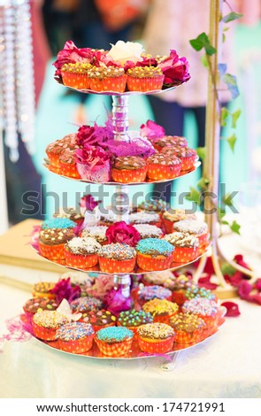 Cupcakes decorated with icing and flowers - stock photo