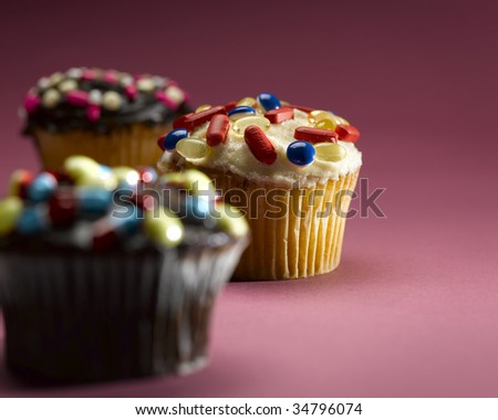 Cupcakes decorated with pills, close-up - stock photo