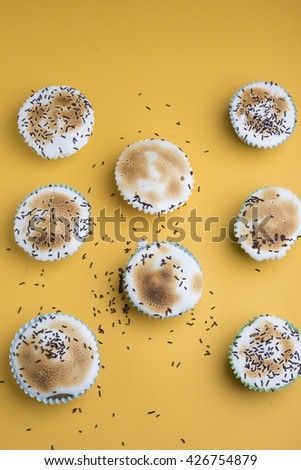 Cupcakes decorated with sprinkles and frosting