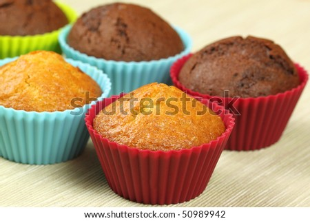Cupcakes in colorful silicone molds - stock photo