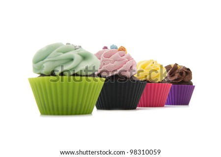 Cupcakes in line over white. Focus on one. - stock photo
