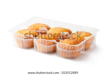 Cupcakes in retail package. Isolated on a white. - stock photo
