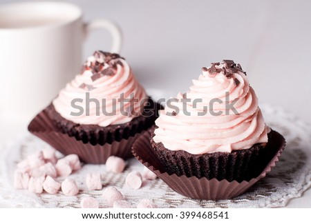 cupcakes on a table with coffee