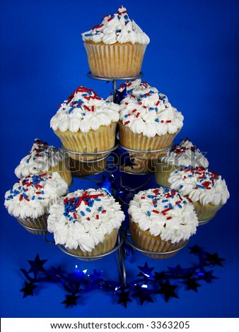 cupcakes on a tiered rack with patriotic sprinkles and decorations - stock photo