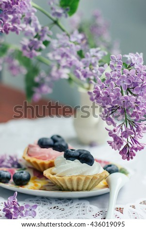 cupcakes on purple background - stock photo