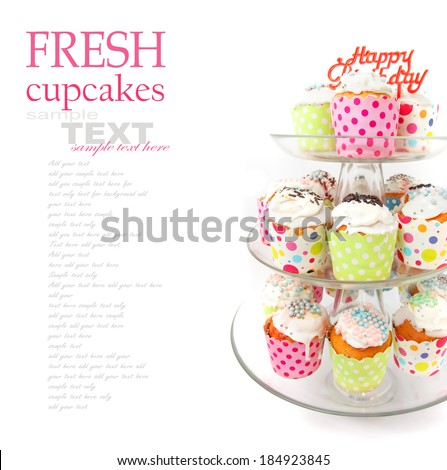 Cupcakes on the cupcake stand for birthday isolated on white  - stock photo