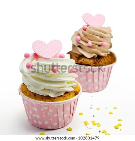 Cupcakes on white background - stock photo
