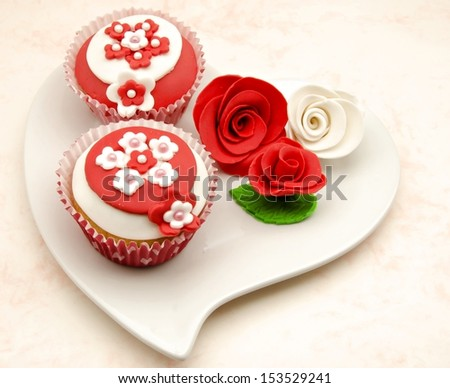 Cupcakes served in a heart shaped dish - stock photo