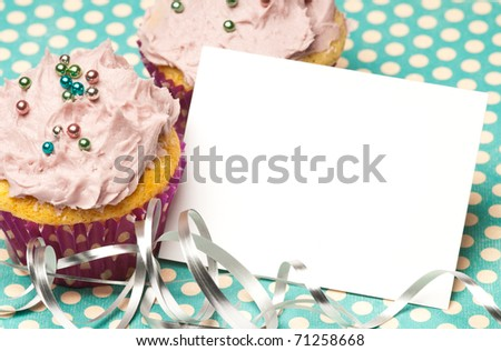 Cupcakes with a blank paper to write your own message - stock photo