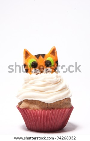 Cupcakes with a cat on top - stock photo