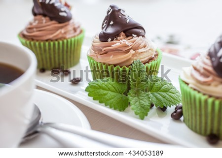 Cupcakes with a cup of hot black coffee