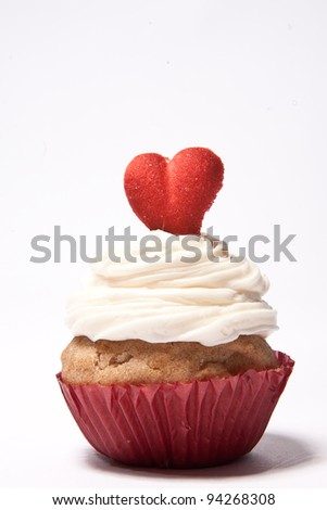 Cupcakes with a red heart on top - stock photo