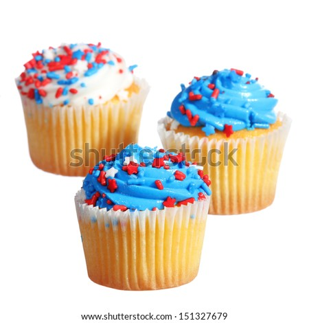 cupcakes with blue and white cream and red stars on the top. patriotic decorated, isolated on white background - stock photo