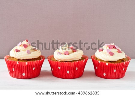 Cupcakes with butter cream and sugar hearts