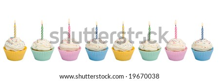 Cupcakes with candle border on white background - stock photo