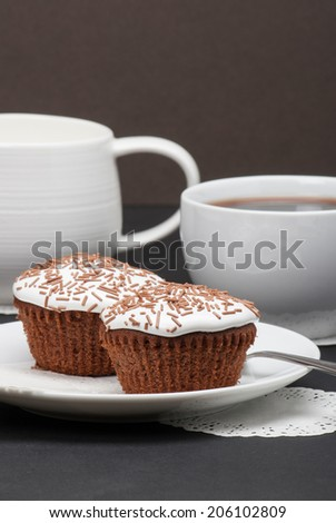 Cupcakes With Cocoa White Cream And Sprinkles. Coffee And Milk.