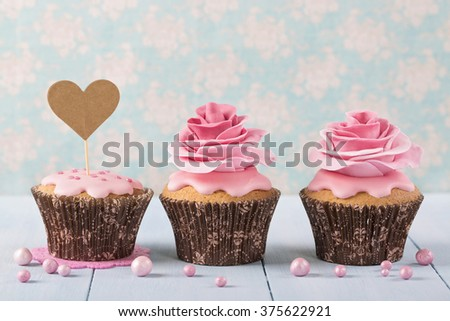 Cupcakes with heart cakepick for text - stock photo