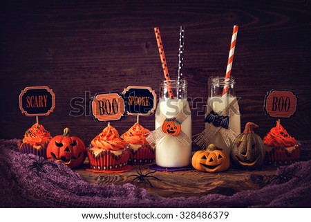 Cupcakes with milk for halloween party - stock photo