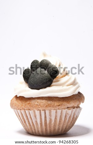 Cupcakes with Paw print of a dog on top - stock photo
