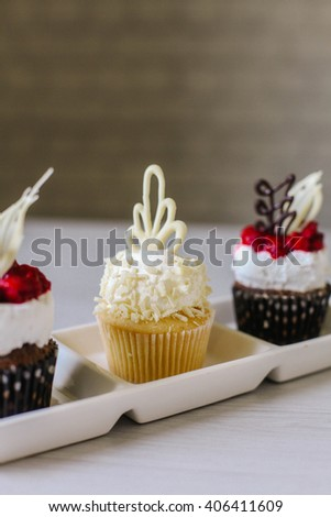 Cupcakes with raspberry, coconut and chocolate.