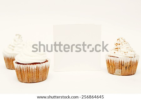 Cupcakes with whip cream and blank card - add own text - stock photo