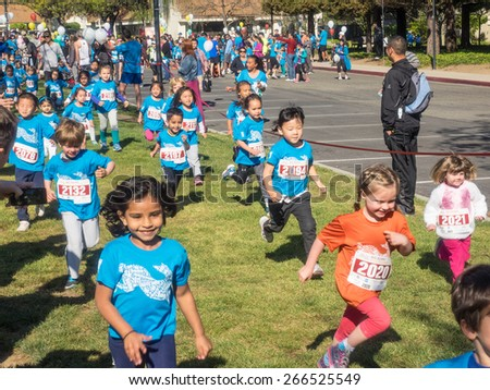 CUPERTINO, CA - APRIL 4: Annual Big Bunny Fun Run, an event that celebrates positive, healthy, and connected community on April 4, 2015 in Cupertino. - stock photo