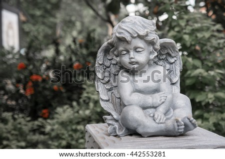 Cupid angel statue