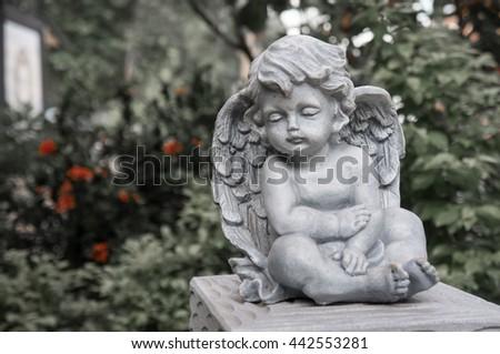 Cupid angel statue - stock photo