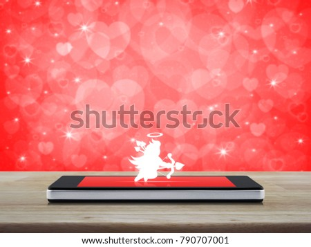 Cupid Icon On Modern Smartphone Screen Wooden Table Over Blur Red Heart Background Internet