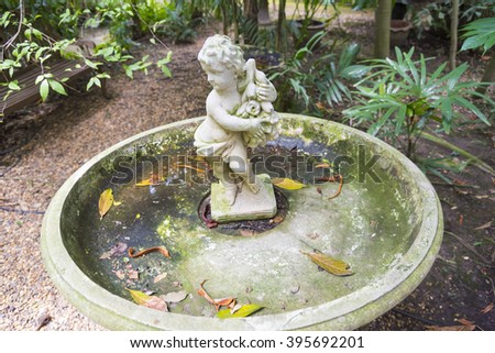 cupid statue - stock photo