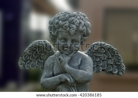 cupid statue in park - stock photo