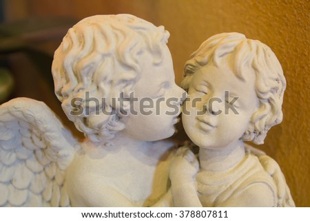 Cupid statues were kissing - stock photo