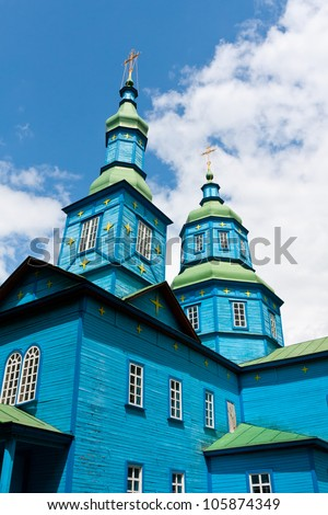 cupola of old wooden church on blue sky background - stock photo