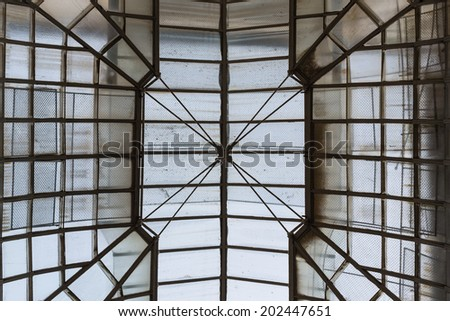 Cupola of retro glass house roof evening inside view - stock photo