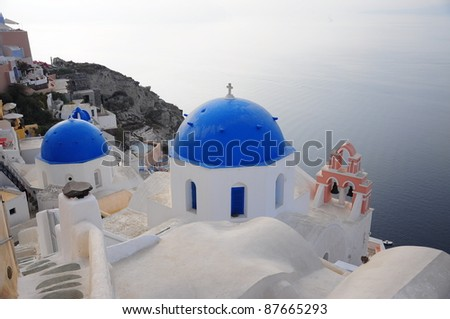 Cupolas with the Caldera in Santorini - stock photo