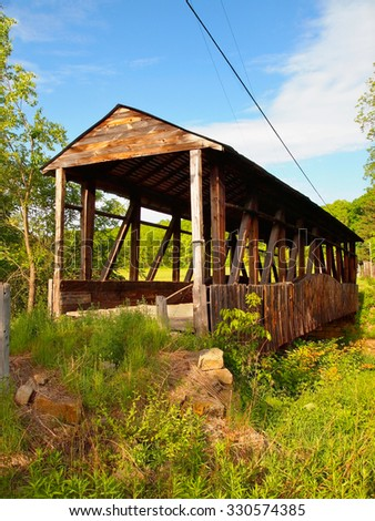 Cuppett's Covered Bridge, in Napier Township, Pennsylvania, in Bedford County, on a bright, sunny, spring day.  - stock photo
