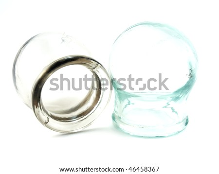 Cupping glasses over white - stock photo