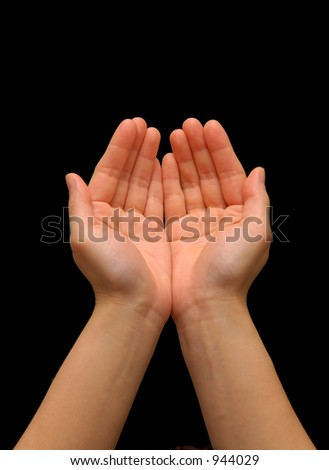Cupping hand gesture, isolated with a black background