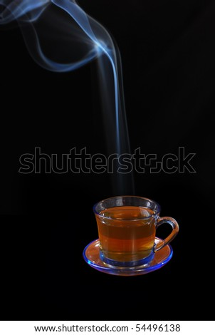 Cups filled with tea and the steam rising