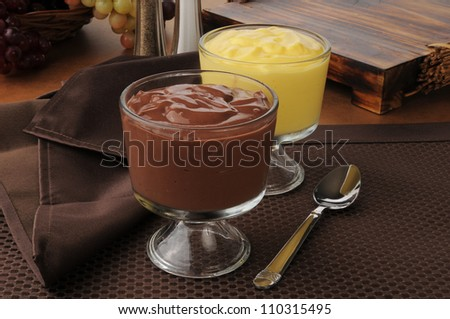 Cups of chocolate and vanilla pudding - stock photo