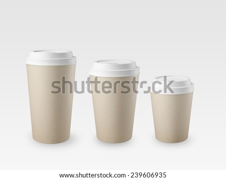 Cups of different sizes on a white background - stock photo