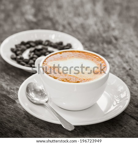 cups of espresso on brown